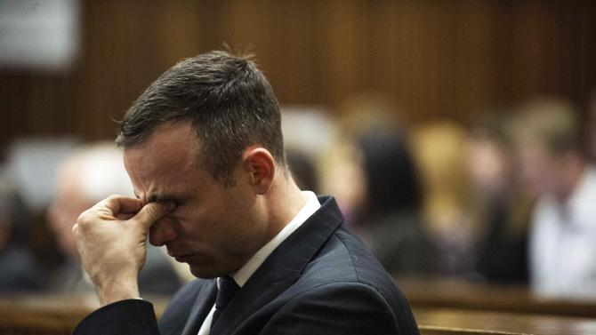 South African Olympic and Paralympic athlete Oscar Pistorius reacts during his murder trial in the North Gauteng High Court in Pretoria