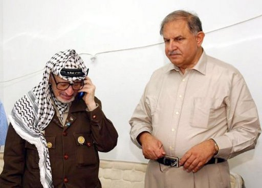 A 2002 picture from the Palestinian press office shows Hani al-Hassan (right) with Palestinian late leader Yasser Arafat in Ramallah. Hassan has died aged 74