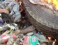 A young mother, accused of sorcery, was stripped naked, reportedly tortured with a branding iron, tied up, splashed with fuel and set alight on a pile of rubbish topped with car tyres, in Mount Hagen city in the Western Highlands of Papua New Guinea, on February 6, 2013. She was torched by villagers who claimed she killed a six-year-old boy through 'sorcery.'