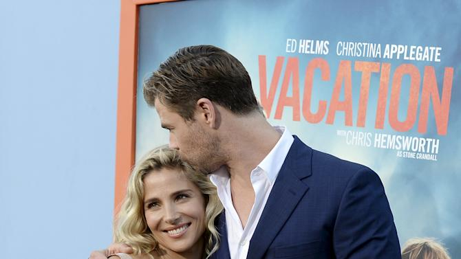 "Cast member Chris Hemsworth kisses model Elsa Pataky as they pose during the premiere of the film ""Vacation"" at the Regency Village Theatre in the Westwood section of Los Angeles"