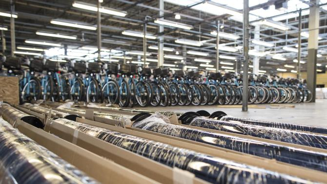 In this Tuesday, June 11, 2013 photo, fully assembled and ready to use bikes sit at the Divvy roll-out facility in Chicago. Chicago's new bike-share program, Divvy, will start in two weeks with about 750 bikes at 75 solar-powered docking stations and expand over the next year to at least 4,000 bikes at 400 stations scattered across the city. Users can get a $75 annual membership or a $7 day pass. (AP Photo/Scott Eisen)