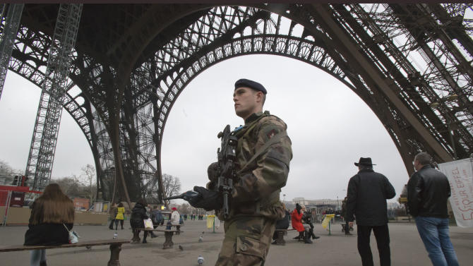 A French soldiers patrols under the Eiffel tower, Sunday, Jan. 13, 2013.  France has ordered tightened security in public buildings and transport following action against radical Islamists both in Mali and Somalia, French President Francois Hollande said yesterday. (AP Photo/Michel Euler)