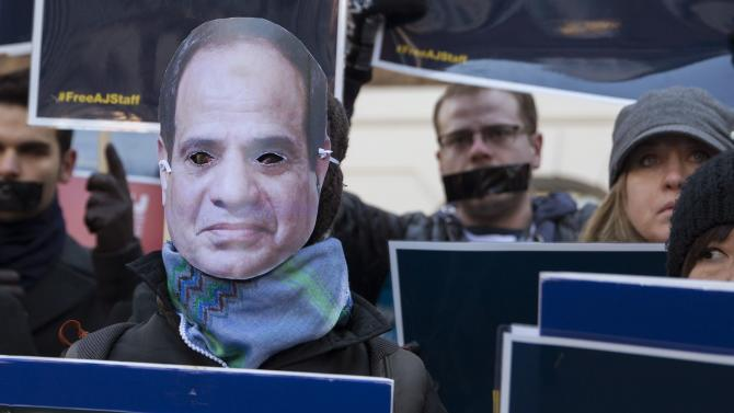 A protester wears a mask of Egypt's President Abdel Fattah el-Sisi during a demonstration in London