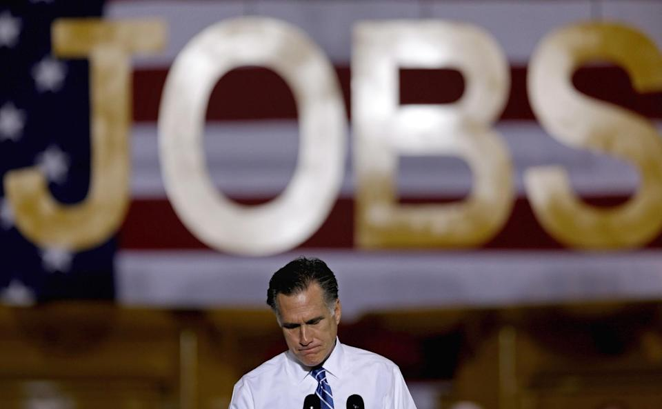 Republican presidential candidate, former Massachusetts Gov. Mitt Romney pauses as he speaks at a campaign event at Screen Machine Industries, Friday, Nov. 2, 2012, in Etna, Ohio. (AP Photo/David Goldman)