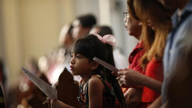 An Indonesian girl attends a mass on Christmas day at Jakarta Cathedral in Jakarta