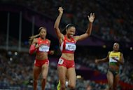 Allyson Felix of the United States celebrates after winning the women's 200m final at the Olympics on Wednesday