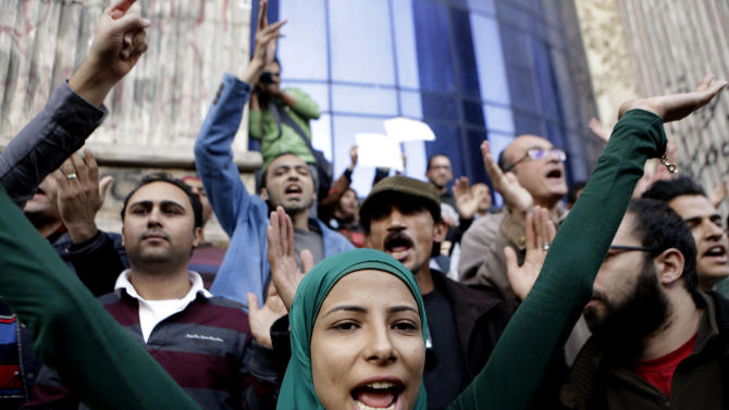 Egyptians chant slogans denouncing toppled President Hosni Mubarak during a protest in front of the press syndicate in Cairo, Egypt, Tuesday, Dec. 2, 2014. A judge on Saturday dismissed the case against Mubarak and acquitted his security chief over the killing of hundreds of protesters during Egypt's 2011 uprising. (AP Photo/Amr Nabil)