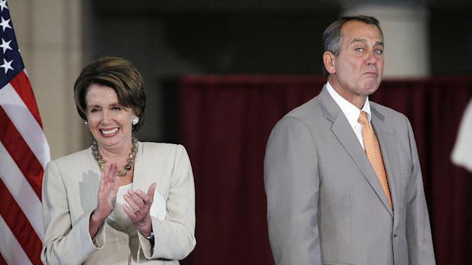House Speaker John Boehner, R-Ohio, right, and House Minority Leader Nancy Pelosi, D-Calif., left, are seen on stage during a Congressional Gold Medal ceremony to honor the surviving members of the Montford Point Marines, at the U.S. Capitol in Washington, Wednesday, June 27, 2012. Montford Point Marines were the first African Americans to serve in the Marines and almost 400 attended the ceremony. Nearly 20,000 African Americans trained at the segregated Montford Point in Camp Lejeune, N.C. (AP Photo/Pablo Martinez Monsivais)