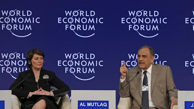 Kosovo's President Jahjaga listens as Iraq's Deputy PM al-Mutlaq speaks during a session on the last day of the World Economic Forum at the Dead Sea