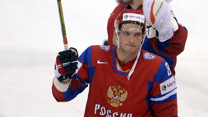 Russia's Alexander Ovechkin rasies his stick to the crowd after the 3-8 loss to USA  at the 2013 Ice Hockey IIHF World Championships Group B Quarterfinal match Russia vs USA in Helsinki, Finland on Thursday  May 16, 2013. (AP Photo/LEHTIKUVA / Martti Kainulainen) FINLAND OUT