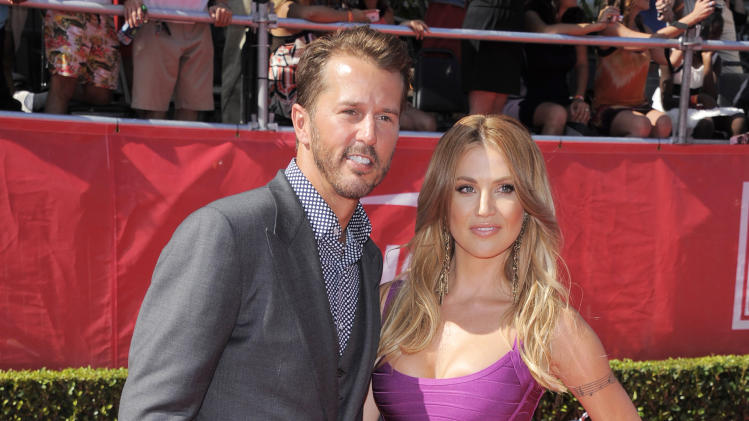 FILE - This July 11, 2012 file photo shows retired hockey player Mike Modano, left, and his wife Willa Ford at the ESPY Awards on in Los Angeles. Modano and actress Willa Ford have decided to end their five-year marriage. Modano spokesman Rob Scichili said Wednesday, Aug. 8, the couple was divorcing but didn't have further details. The 42-year-old Modano and Ford married in 2007 in Athens, Texas. (Photo by Chris Pizzello/Invision/AP, file)