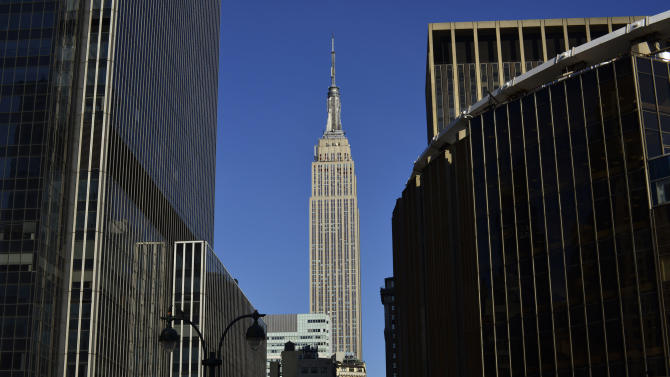 This Thursday, May 2, 2013 photo shows New York's Empire State Building in midtown Manhattan. A Manhattan judge on Thursday backed a $55 million settlement in a court battle over the Empire State Building, effectively clearing the way for a plan to let the public buy shares in the famous New York City landmark. (AP Photo/Patrick Sison)