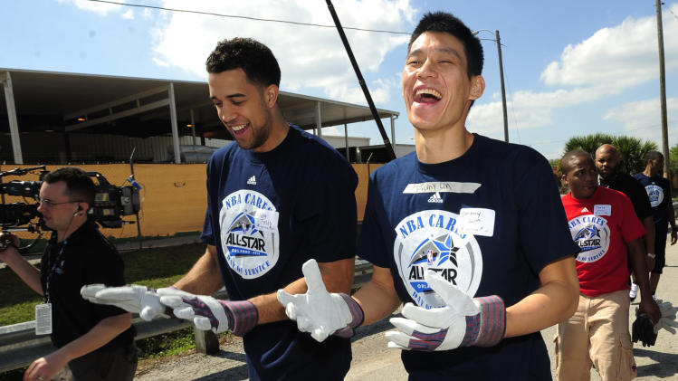 New York Knicks players Jeremy Lin, right, and Landry Fields laugh as they prepare to work as part of the NBA Cares All-Star Day of Service on Feb 24, 2012 in Orlando, Fla.  (Scott A. Miller/AP Images for Rebuilding Together)