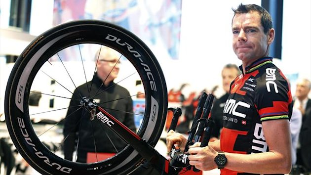 BMC Racing Team rider Cadel Evans of Australia holds his bike as he arrives at the cycling team's official presentation in Nazareth, near Ghent  (Reuters)