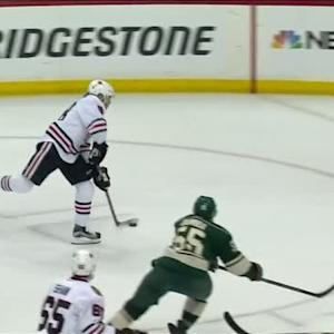 Kane flips a low shot through Dubnyk's legs