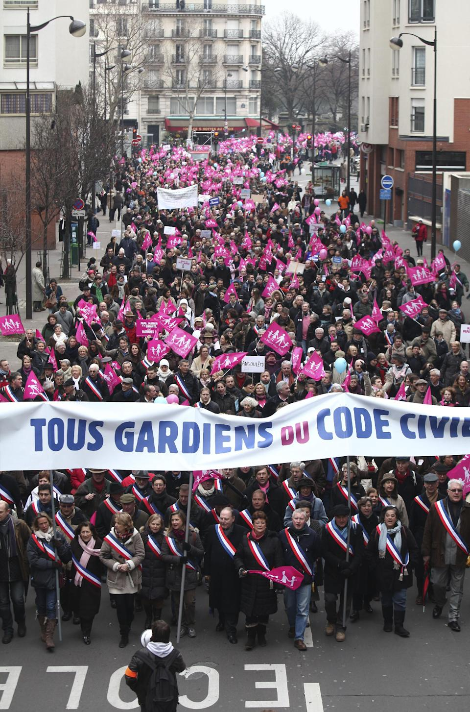"People march behind a banner reading ""All guards of the Civil Code"" during a demonstration in Paris, Sunday, Jan. 13, 2013. Many thousands of protesters are mobilizing against the French president's plan to legalize gay marriage, streaming into Paris by bus, car and specially reserved high-speed train. (AP Photo/Thibault Camus)"