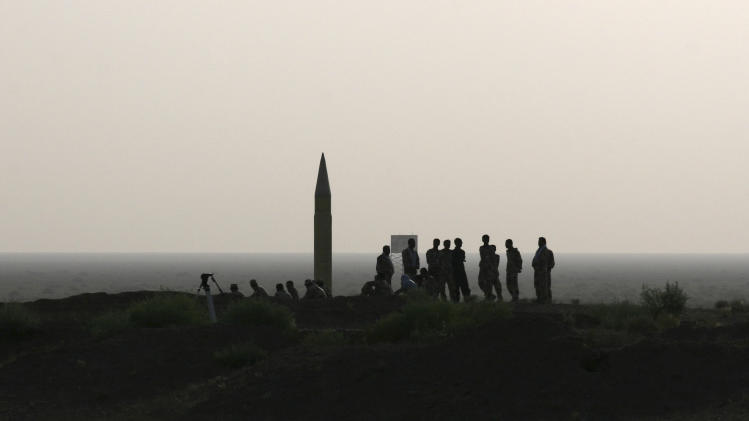 In this photo released by the semi-official Iranian Mehr News Agency, and taken on Tuesday, June 28, 2011, Iranian revolutionary Guards personnel, wait to launch of Shahab-2 missile during their maneuvers outside the city of Qom, Iran. (AP Photo/Mehr News Agency, Raouf Mohseni)