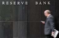 A businessman passes by the Reserve Bank of Australia (RBA) building in Sydney. Australia's central bank upped its annual growth forecast Friday after a strong first half, but it warned that resources investment -- a key driver of the economy -- would peak by 2014