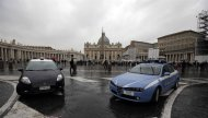Italian police, left, and carabinieri cars are parked outside St. Peter&#39;s Square, at the V atican, Saturday, Feb. 23, 2013 As 100.000 pilgrims are expected to crowd St. Peter&#39;s Square for the last Angelus prayer of Pope Benedict XVI on Sunday morning, the Rome municipality is expected to increase by more then 30% the law enforcement agents, volunteers and transportation, while more then 2000 cctv security cameras will monitor the Roman territory with dozens aiming only at the areas surrounding the Vatican. (AP Photo/Gregorio Borgia)