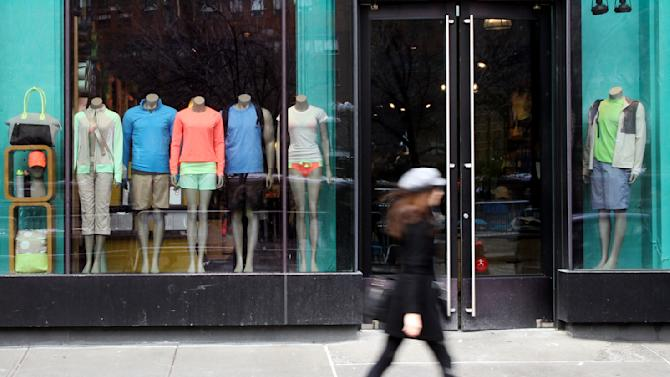 FILE - In this Tuesday, March 19, 2013, file photo, a woman walks past the Lululemon Athletica store at Union Square in New York. Just a few months after Lululemon pulled yoga pants from shelves because they were too sheer, costing them million in sales, the company is fielding new complaints about the quality. (AP Photo/Mary Altaffer, File)