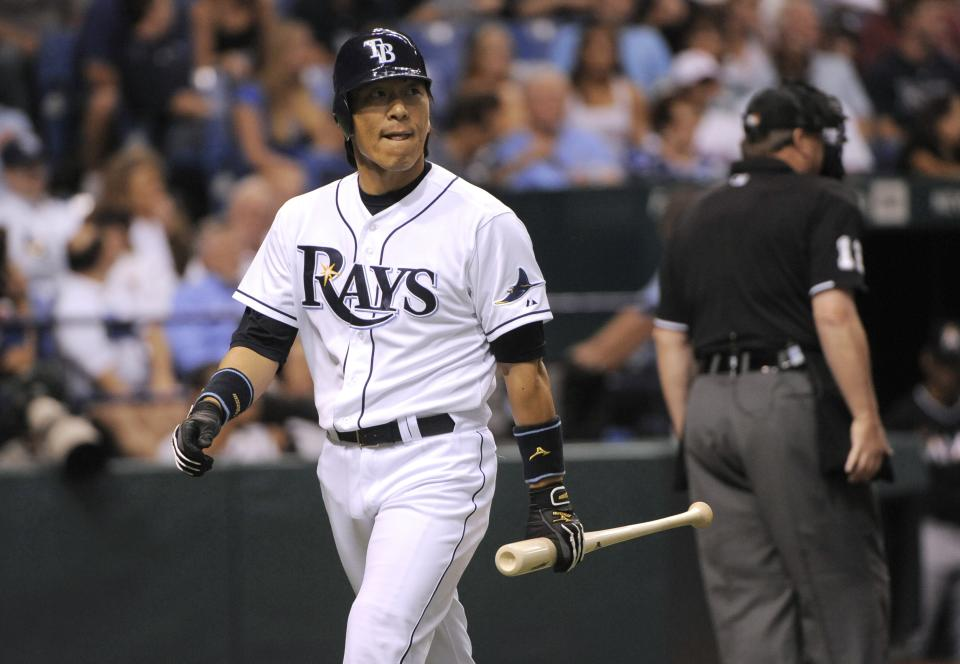 Tampa Bay Rays' Hideki Matsui walks back to the dugout after striking out swinging against Miami Marlins starting pitcher Anibal Sanchez during the second inning of an interleague baseball game Saturday, June 16, 2012, in St. Petersburg, Fla. (AP Photo/Brian Blanco)
