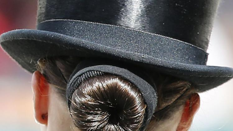 The hair-style of U.S rider Laura Graves is seen during the Individual freestyle Competition Dressage event at the World Equestrian Games at the d'Ornano stadium in Caen