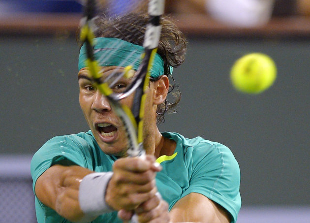 Rafael Nadal, of Spain, returns a shot to Roger Federer, of Switzerland, during their match at the BNP Paribas Open tennis tournament, Thursday, March 14, 2013, in Indian Wells, Calif. (AP Photo/Mark J. Terrill)