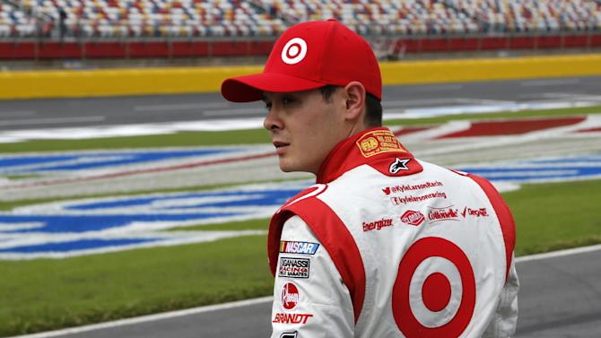 Kyle Larson looks down pit road after practice for Saturday's NASCAR Sprint Cup series auto race at Charlotte Motor Speedway in Concord, N.C., Friday, Oct. 11, 2013