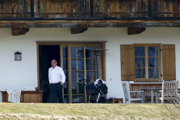 Hoeness, resigned president and chairman of Bayern Munich, walks outside his house in the Bavarian town of Bad Wiessee