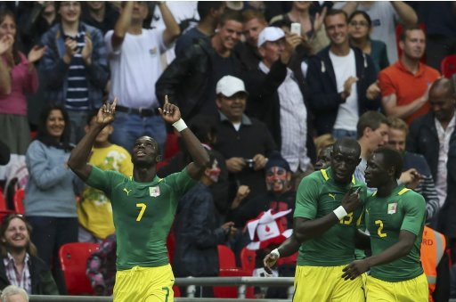 Senegal's Moussa Konate celebrates his goal against Uruguay during their men's preliminary first round Group A soccer match at the London 2012 Olympic Games in the Wembley Stadium in London