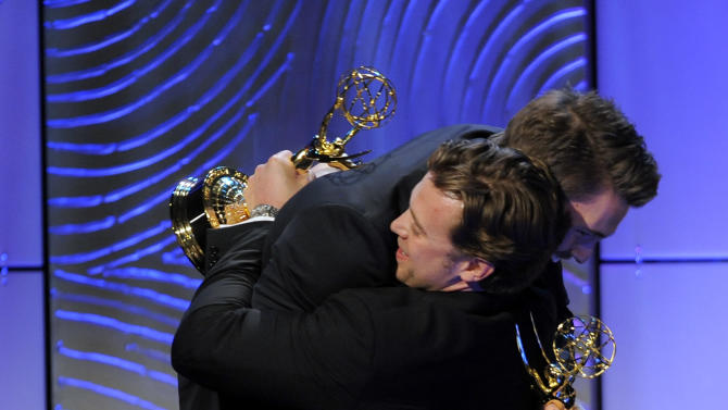 """Scott Clifton, left, from the cast of """"The Bold and the Beautiful,"""" congratulates co-winner Billy Miller, from the cast of """"The Young and the Restless,"""" as they accept the award for outstanding supporting actor in a drama series at the 40th Annual Daytime Emmy Awards on Sunday, June 16, 2013, in Beverly Hills, Calif. (Photo by Chris Pizzello/Invision/AP)"""