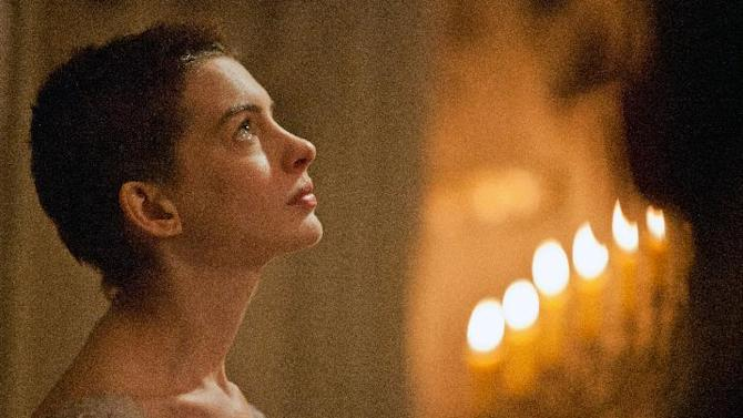 "FILE - This publicity film image released by Universal Pictures shows actress Anne Hathaway portraying Fantine, a struggling, sickly mother forced into prostitution in 1800s Paris, in a scene from the screen adaptation of ""Les Miserables.""  (AP Photo/Universal Pictures, Laurie Sparham, File)"