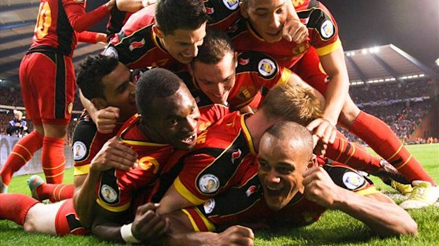 Belgium's Vincent Kompany (bottom) celebrates with team-mates after scoring the 2-0 goal during the 2014 World Cup qualifying football match between Belgium and Scotland at the King Baudouin stadium in Brussels (AFP)