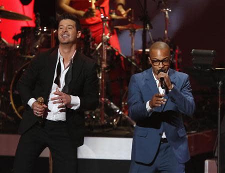 "Robin Thicke performs ""Blurred Lines"" with T.I. at The Grammy Nominations Concert Live - Countdown to Music's Biggest Night event, at Nokia theatre in Los Angeles"