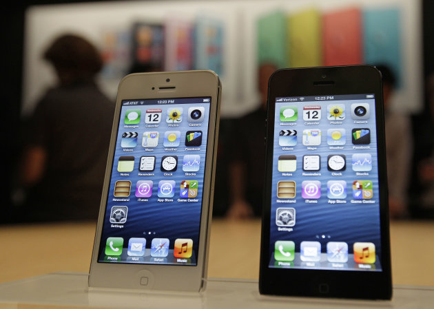 The new Apple iPhone 5 is displayed Wednesday Sept. 12, 2012 following the introduction of new products in San Francisco. The iPhone 5 is a blend of beauty, utility and versatility. (AP Photo/Eric Risberg)