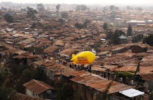 Members of NGO Amnesty International carry a hot air …