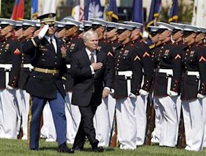 U.S. Defense Secretary Gates reviews an honour guard at the Pentagon