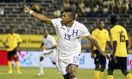 Honduras' Costly celebrates after scoring a goal against Jamaica in their 2014 World Cup qualifying soccer match in Kingston