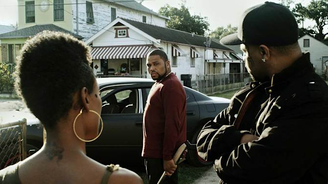 "CORRECTS TO REMOVE REFERENCE TO TATOO-FACED This film image released by Steelyard Pictures shows Anthony Anderson in a scene from ""The Power of Few,"" an independent action-drama filmed in New Orleans. Anderson, star of the NBC sitcom ""Guys With Kids,"" sheds his funnyman persona to play a gun-wielding thug making its limited-release debut on Friday, Feb. 22, 2013. (AP Photo/Steelyard Pictures)"