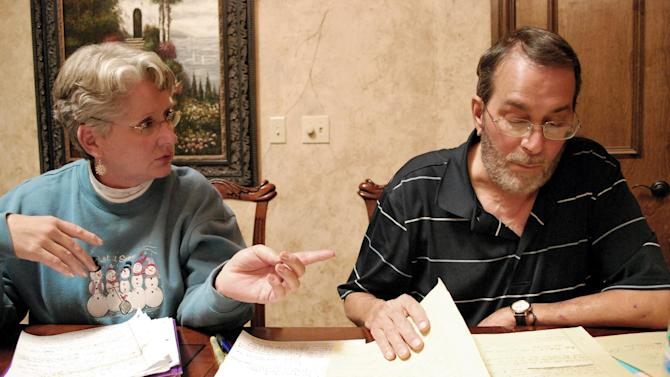 In this Nov. 29, 2012 photo, Kaye O'Brien, left, talks with her husband, Dennis O'Brien, right, in Nashville, Tenn. Dennis O'Brien contracted fungal meningitis after receiving a series of steroid injections in his neck made by a Massachusetts pharmacy that has been linked to an outbreak of fungal meningitis. (AP Photo/Kristin M. Hall)