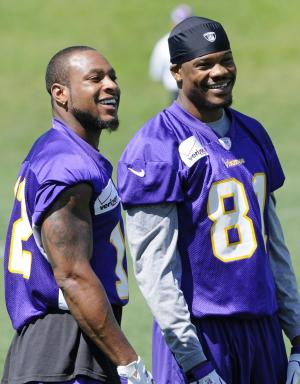 Minnesota Vikings wide receivers Percy Harvin, left, and Jerome Simpson enjoy a break during NFL football practice, Thursday, June 21, 2012, in Eden Prairie, Minn. Harvin has asked to be traded, saying earlier in the week he was upset with the team but not elaborating. (AP Photo/Jim Mone)