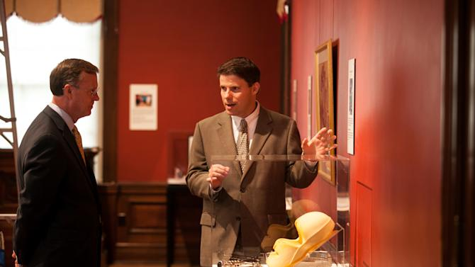 This photo provided by Western Kentucky University, Dan Murph, right, talks about a new museum collection with Western Kentucky University President Gary Ransdell on Wednesday, Sept. 12, 2012, in Bowling Green, Ky.  Murph came up with the idea of starting a collection of ordinary stuff that was used by people who made noteworthy accomplishments in science, entertainment, the arts and politics.(AP Photo/Western Kentucky University, Clinton Lewis)