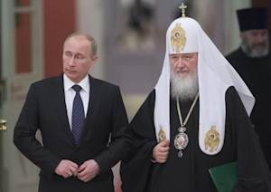Russia's President Vladimir Putin and Patriarch of Moscow and All Russia Kirill arrive for the meeting with Russian Orthodox church bishops in Moscow