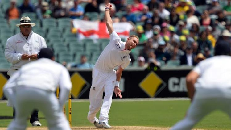 England paceman Stuart Broad (C) gets the wicket of Australia's batsman David Warner during day one of the second Ashes cricket Test between England and Australia in Adelaide on December 5, 2013