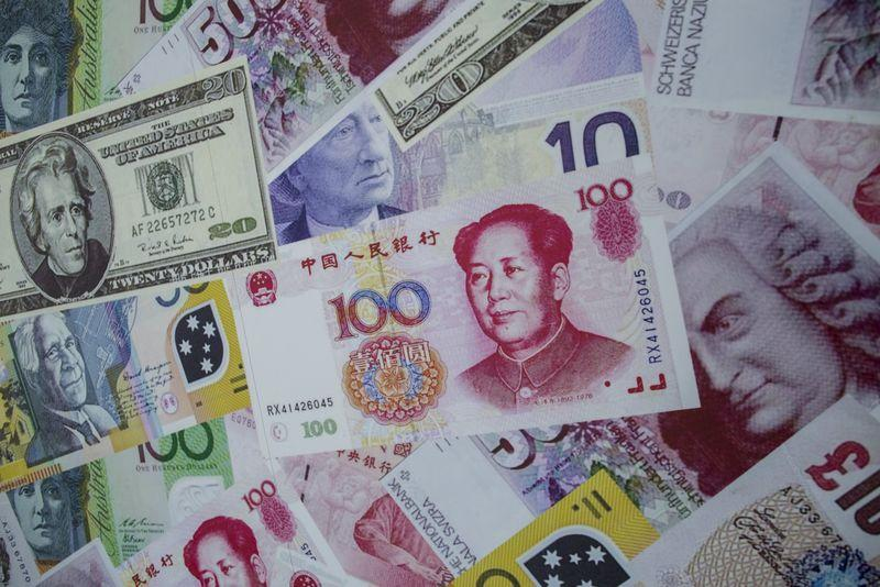 China's yuan ends firmer on suspected intervention, stock rally