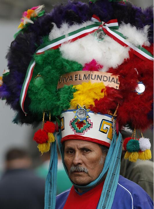 "A Mexico soccer fan wears a costume that reads in Spanish ""Long live the World Cup"" ahead of a 2014 World Cup qualifying match between Mexico and New Zealand in Mexico City, Wednesday, Nov. 13, 2013."