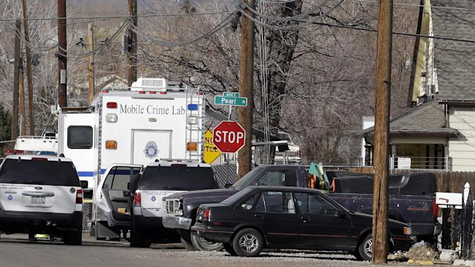 Police investigate the scene of a shooting where a woman and two children were found dead and a third child wounded in the Globeville neighborhood in Denver on Wednesday, Feb. 6, 2013.  The shooting appeared to have been isolated and there was no indication a shooter is on the loose, police Major Crimes Cmdr. Ron Saunier said.  (AP Photo/Ed Andrieski)