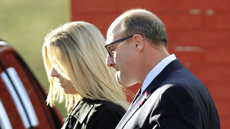 Kansas City Chiefs general manager Scott Pioli, right, leaves a memorial service for Jovan Belcher at the Landmark International Deliverance and Worship Center, Wednesday, Dec. 5, 2012, in Kansas City, Mo. Belcher shot his girlfriend, Kasandra Perkins, at their home Saturday morning before driving to Arrowhead Stadium and turning the gun on himself. (AP Photo/Ed Zurga)