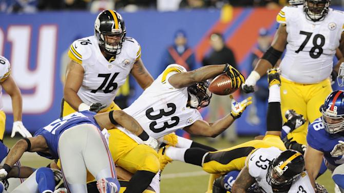 Pittsburgh Steelers running back Isaac Redman (33) dives for the winning touchdown during the fourth quarter of their NFL football game against the New York Giants, Sunday, Nov. 4, 2012, in East Rutherford, N.J. The Steelers won 24-20. (AP Photo/Bill Kostroun)