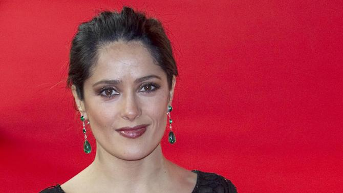 """FILE - In this Feb. 15, 2012 file photo, actress Salma Hayek arrives for the screening of the film, """"As Luck Would Have It """" (La Chispa De La Vida), at the 62 edition of International Film Festival Berlinale, in Berlin. Hayek says she is proud to be Mexican and that comments suggesting otherwise were """"lost in translation."""" The 45-year-old actress issued a statement Thursday, Aug. 23, 2012, after German Vogue magazine quoted her as saying she """"hardly had any memories of what it is to be Mexican."""" (AP Photo/Gero Breloer, File)"""